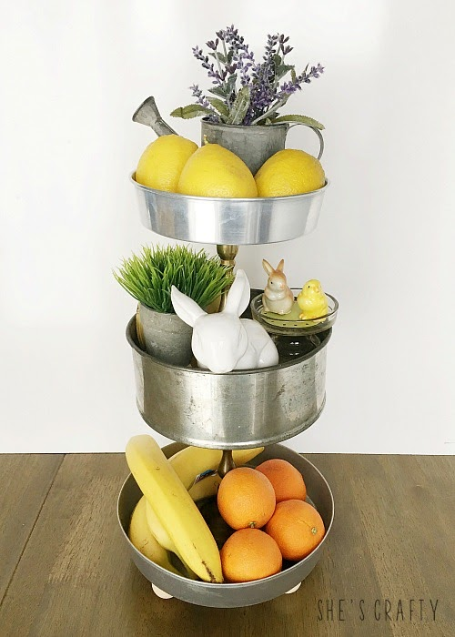 Use a 3 tiered tray to store fruit and seasonal decorations