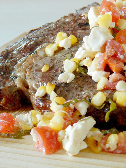 Grilled Ribeyes with Corn & Tomato Relish...the perfect party food!  Juicy steak with the delicious flavors of summer - corn, tomatoes and basil. (sweetandsavoryfood.com)