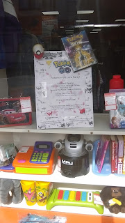 Pokemon Go Lure Party's Poster in Shared Space's Shop Window