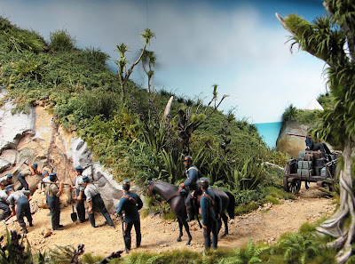 Diorama of 19th-century soldiers fixing a landslide on a track. In the foreground is a large cabbage tree.
