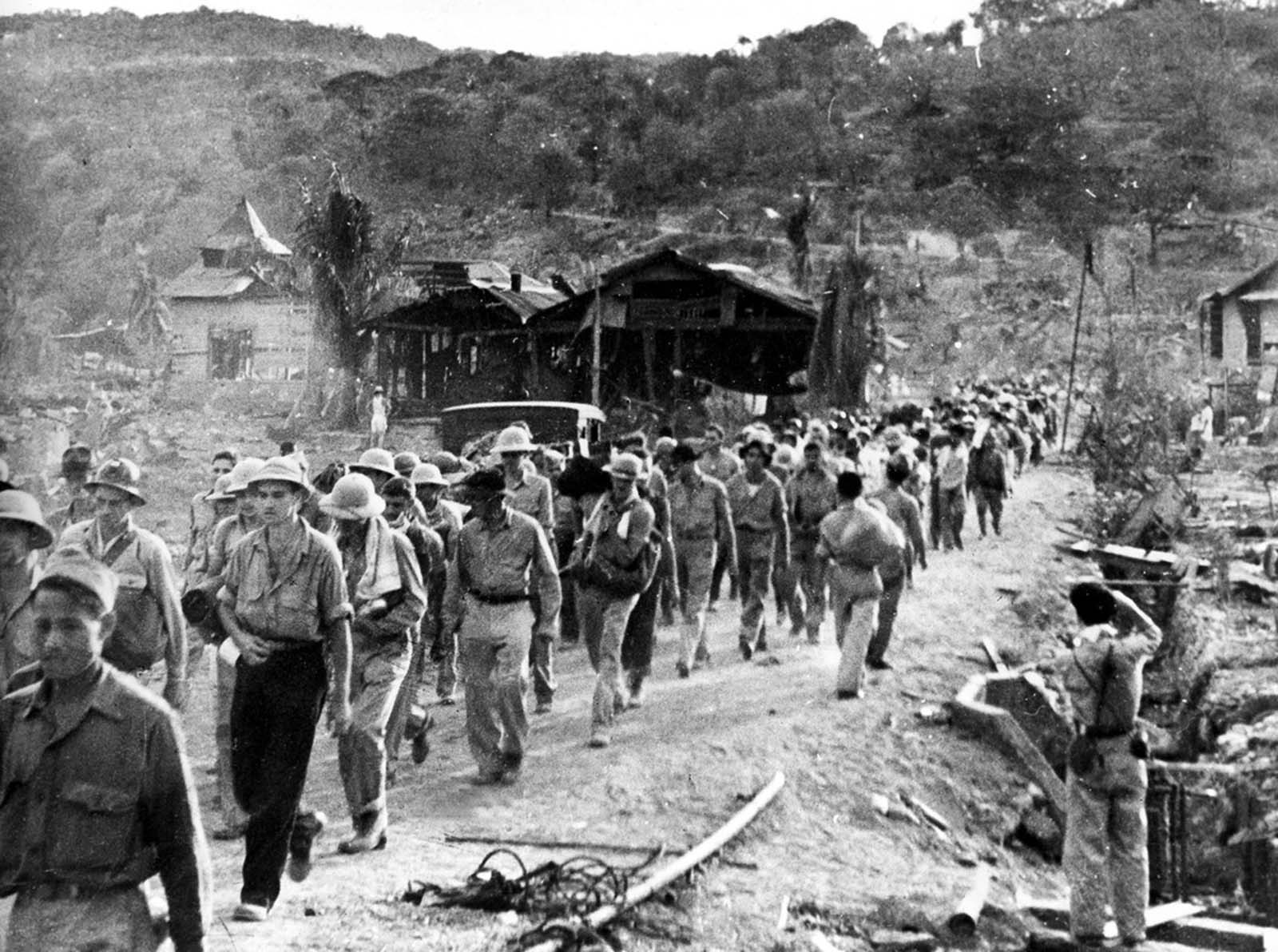 American and Filipino prisoners of war captured by the Japanese are shown at the start of the Death March after the surrender of Bataan on April 9, 1942, near Mariveles in the Philippines. Starting from Mariveles on April 10, some 75,000 American and Filipino prisoners of war were force-marched to Camp O'Donnell, a new prison camp 65 miles away. The prisoners, weakened after a three-month siege, were harassed by Japanese troops for days as they marched, the slow or sick killed with bayonets or swords.