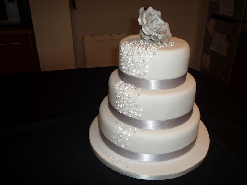 Elaine Allan Cascading diamond and pearl wedding cake