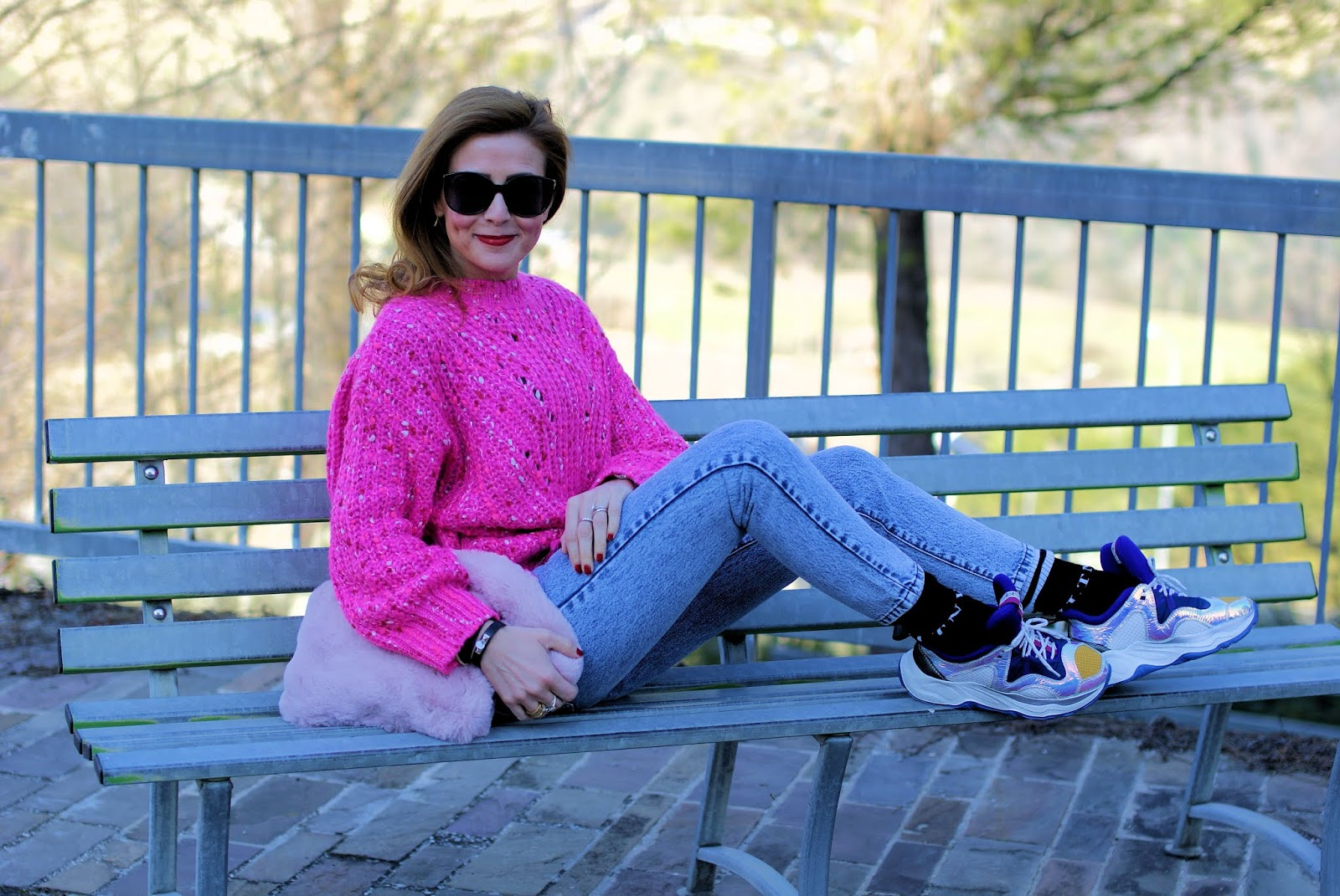 Casual outfit with a maxi distressed pink sweater and furry bag on Fashion and Cookies fashion blog