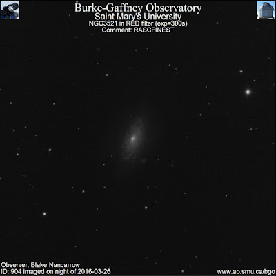 red filter photograph of galaxy NGC 3521