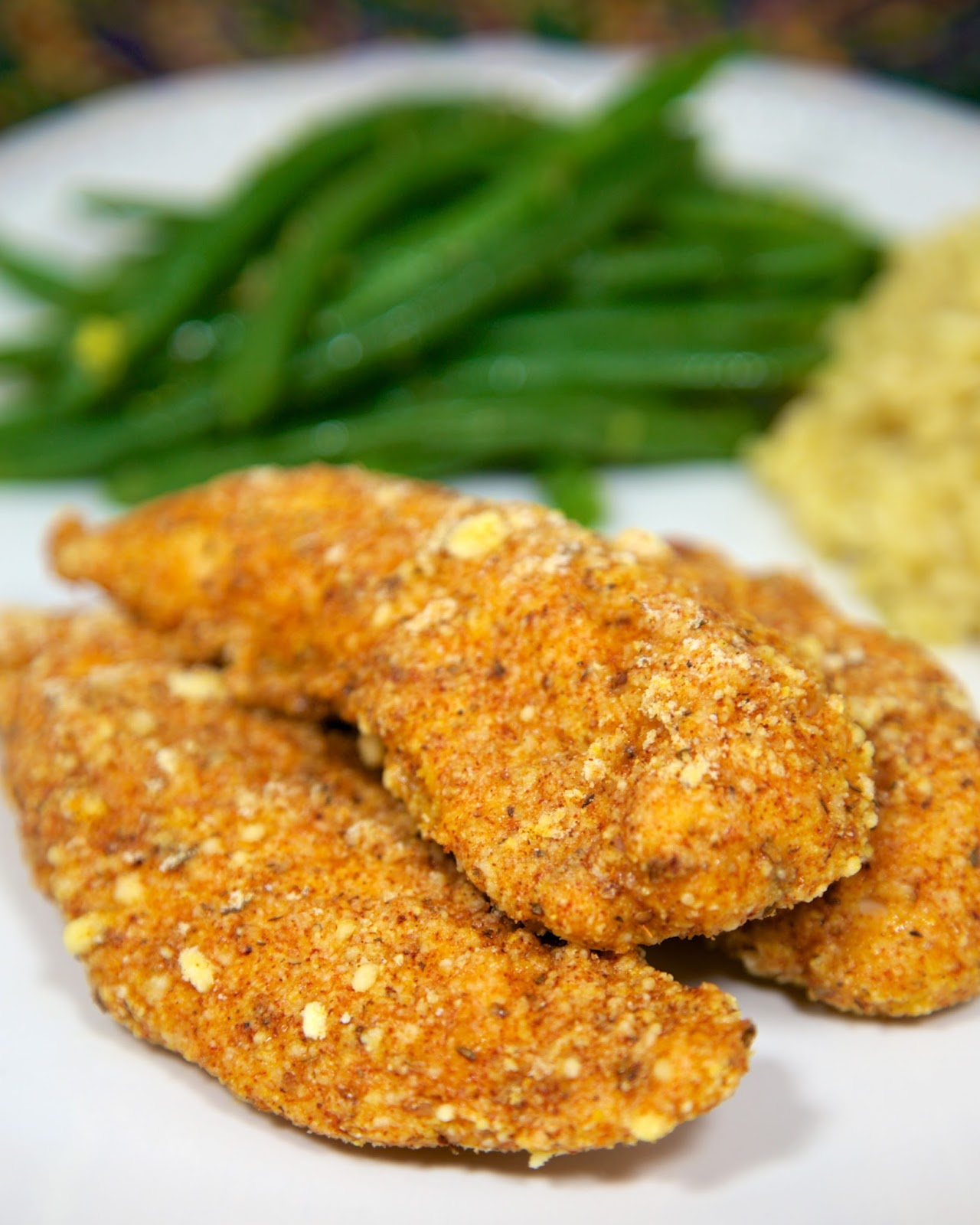 Cajun Cornbread Crusted Chicken Tenders - only 5 ingredients! Chicken, Jiffy mix, cajun seasoning, flour and eggs. Control the heat by adjusting the cajun seasoning. Baked not fried! Ready in about 15 minutes!