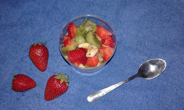 strawberries kiwi and banana dessert with orange juice