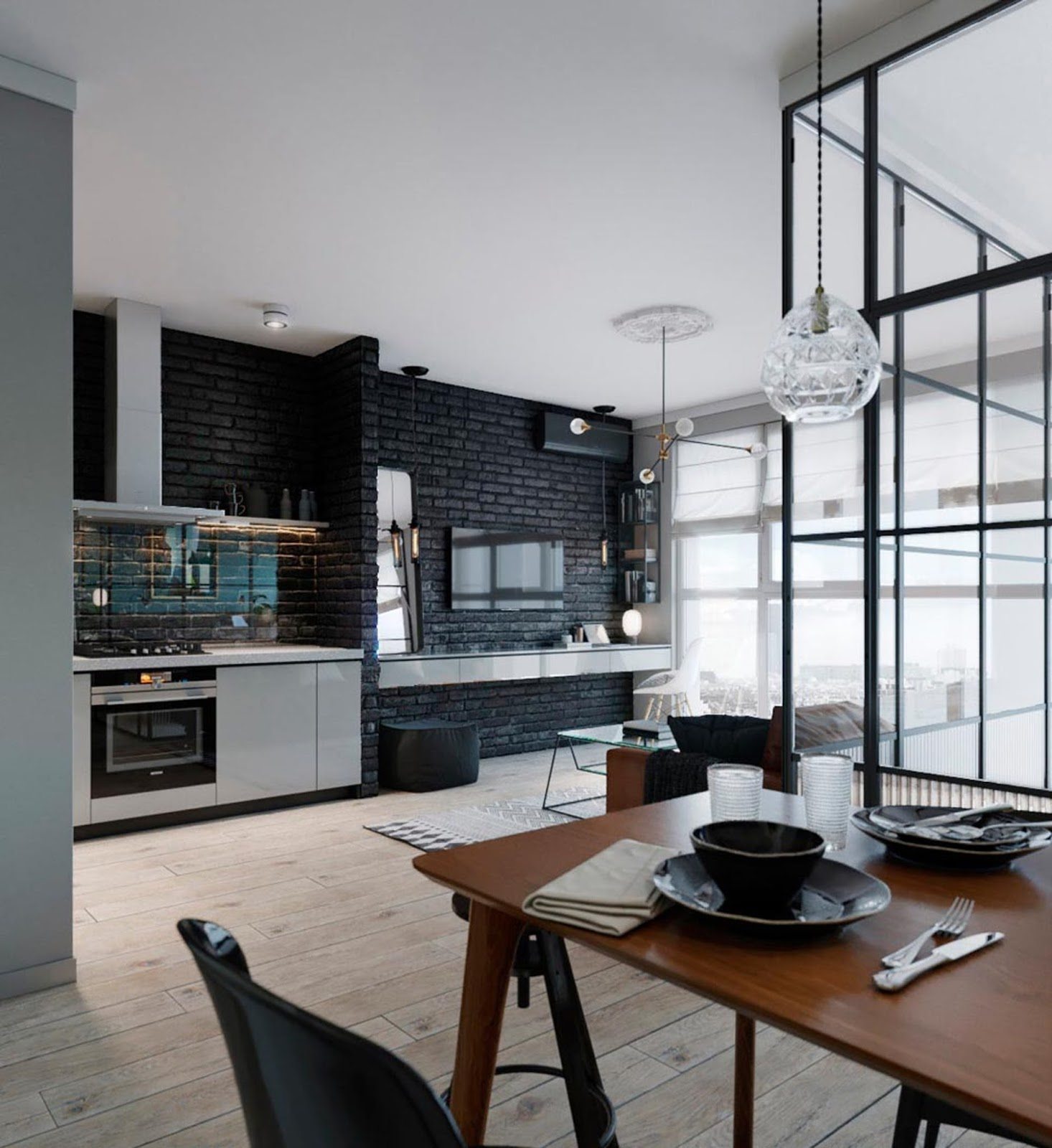 small loft interior with black kitchen and large windows