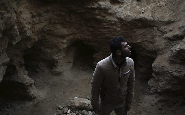 Heavy rain unearths ancient graves in backyard in Gaza