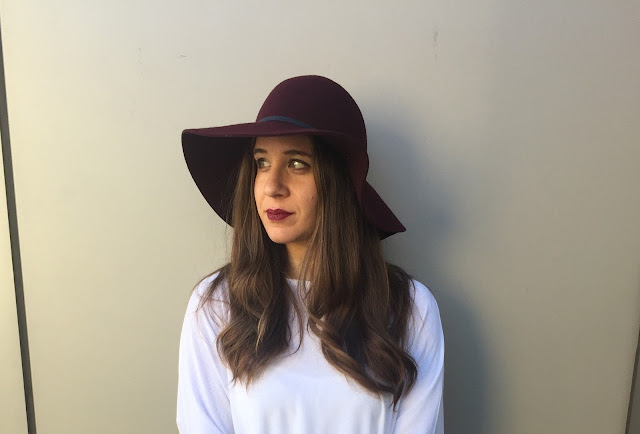 a close up image of blogger with burgundy wool floppy hat from target looking to the side