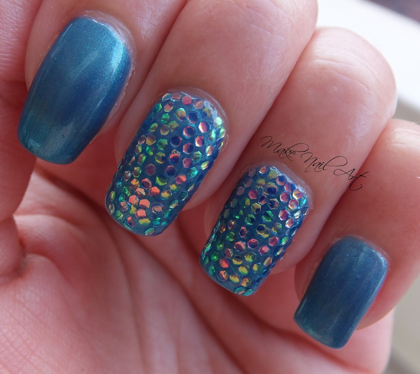 Blue Nails With Glitter On The Ring Finger Pinpoint Properties
