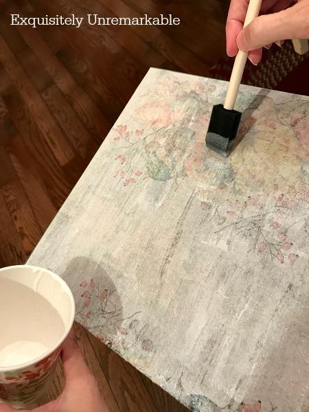 Brushing on mod podge with a foam brush