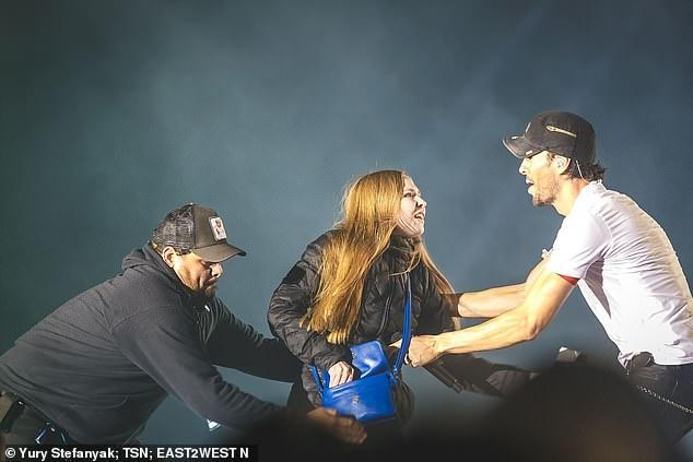 Enrique Iglesias passionately kisses a FAN during concert in Ukraine