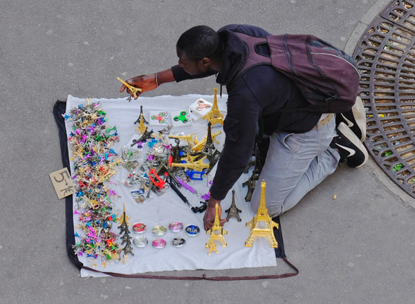 A souvenir seller setting up his display metro Bir-Hakeim. Paris photos by Kent Johnson for Street Fashion Sydney.
