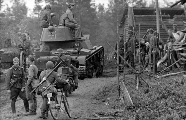 Finnish troops in the border town of Tuulos, Eastern Karelia with captured Soviet T-26 tank 30 June 1941 worldwartwo.filminspector.com