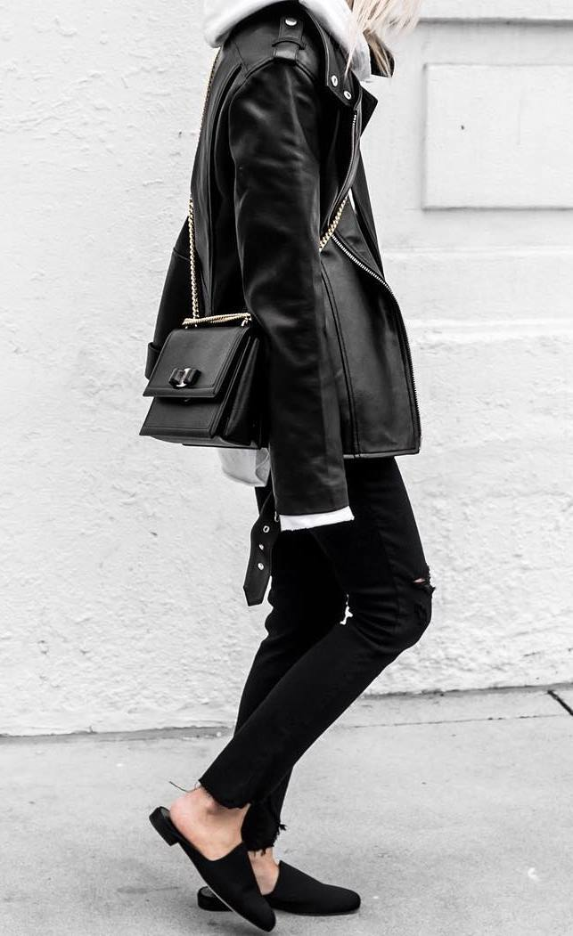 street style inspiration / moto jacket + bag + black skinnies + loafers + sweatshirt