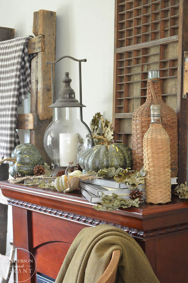 Rustic fall mantel filled with pumpkins and everyday objects.  |  www.andersonandgrant.com