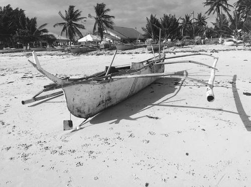 A boat on a beach in Bantayan Island