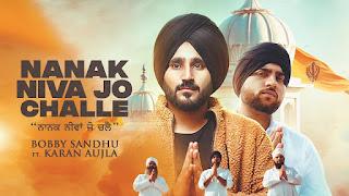 Presenting Nanak Niva jo challe lyrics penned by Saheb Randhawa. New Punjabi song Nanak niva jo challe sung by Karan Aujla & Bobby Sandhu