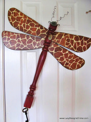 hand painted giraffe print on table leg dragonfly