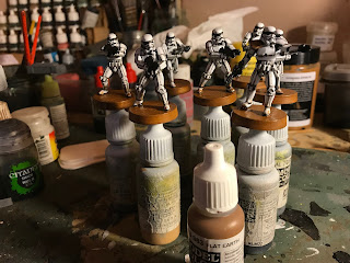 The bases are painted in a basic colour