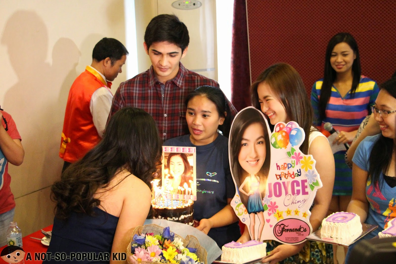 Joyce Ching blowing the candles for her birthday surprise (with Krystal Reyes and Phytos Ramirez)