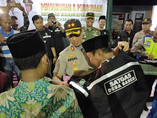 330 Anggota SATGAS Keamanan Desa Kecamatan Pasirian Dikukuhkan Kapolres Lumajang