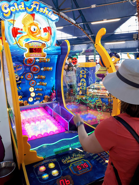 Things to do in North Wales: Play carnival games at the end of Llandudno Pier