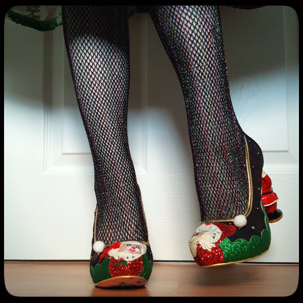 wearing sparkly fishnet tights with glitter Christmas shoes