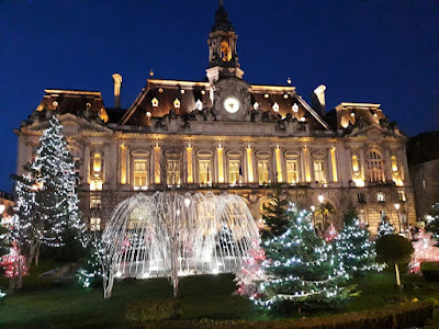 Christmas lights on trees in front of Hotel de Ville in Tours in the Loire Valley