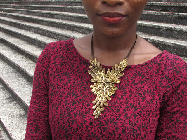 red lips, gold, necklace, fabric pattern
