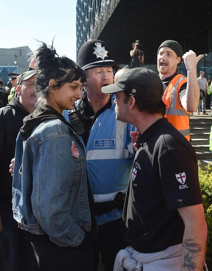 Photo of Woman Staring Down Far-Right Protester Goes Viral