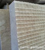 Reinforced marmer pada permukaan bagian belakang