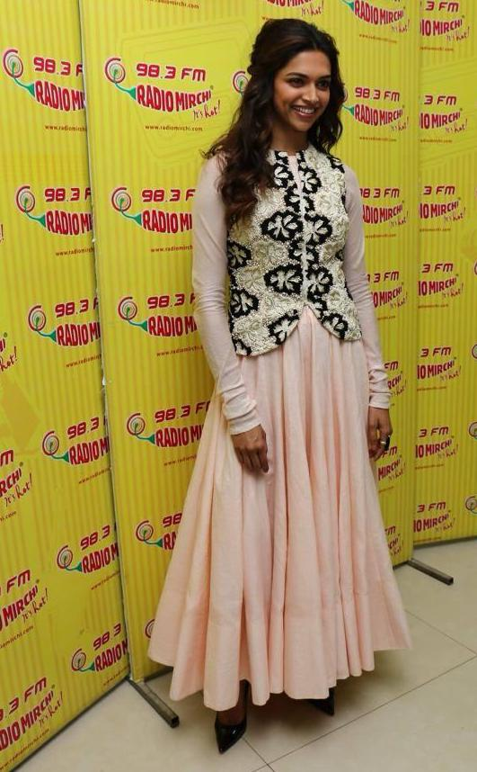 Dress no. 24 Deepika in Peach colour Outfit posing in front of 98.3