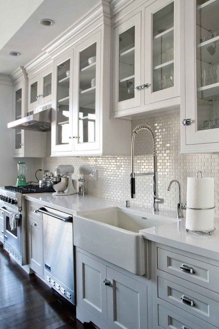 White kitchen with dark flooring