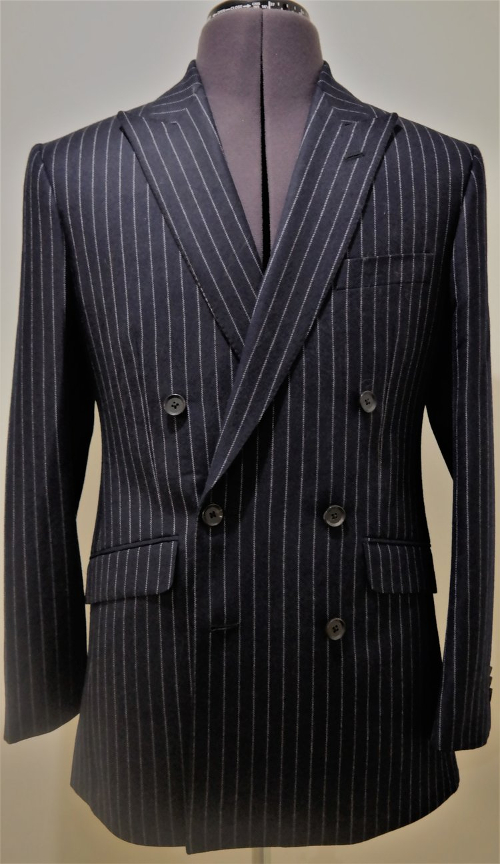 14e29ba4d3cf Chalk stripes are to be found on more than suits too. Here's an interesting  take on the design from Mackintosh, who have produced a coat in a very  broad ...