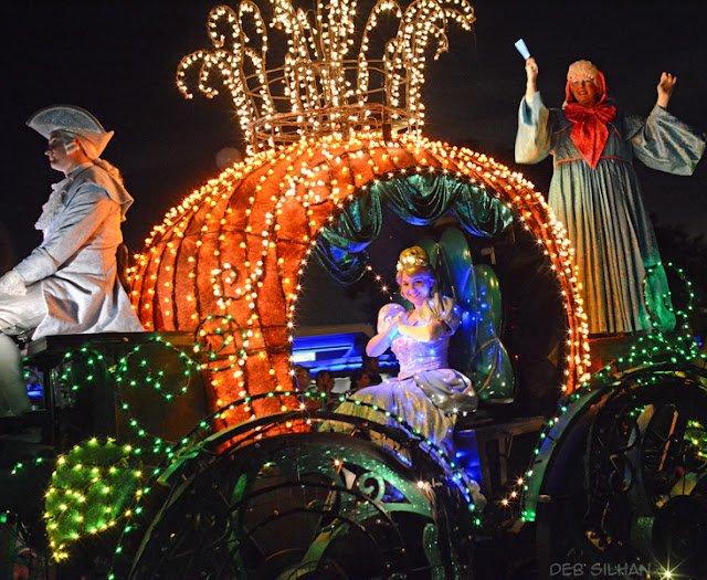 Cinderella waving to her adoring fans during Disney's Main Street Electrical Parade in Walt Disney World