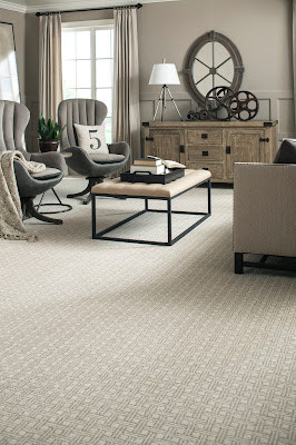 Cool gray carpet with a subtle pattern creates a soothing retreat.