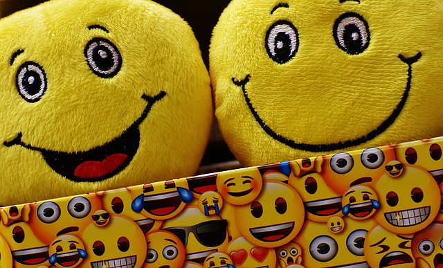 emoji plushies in an emoji box