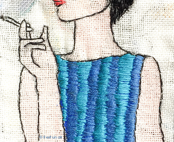 Broderie : femme qui fume