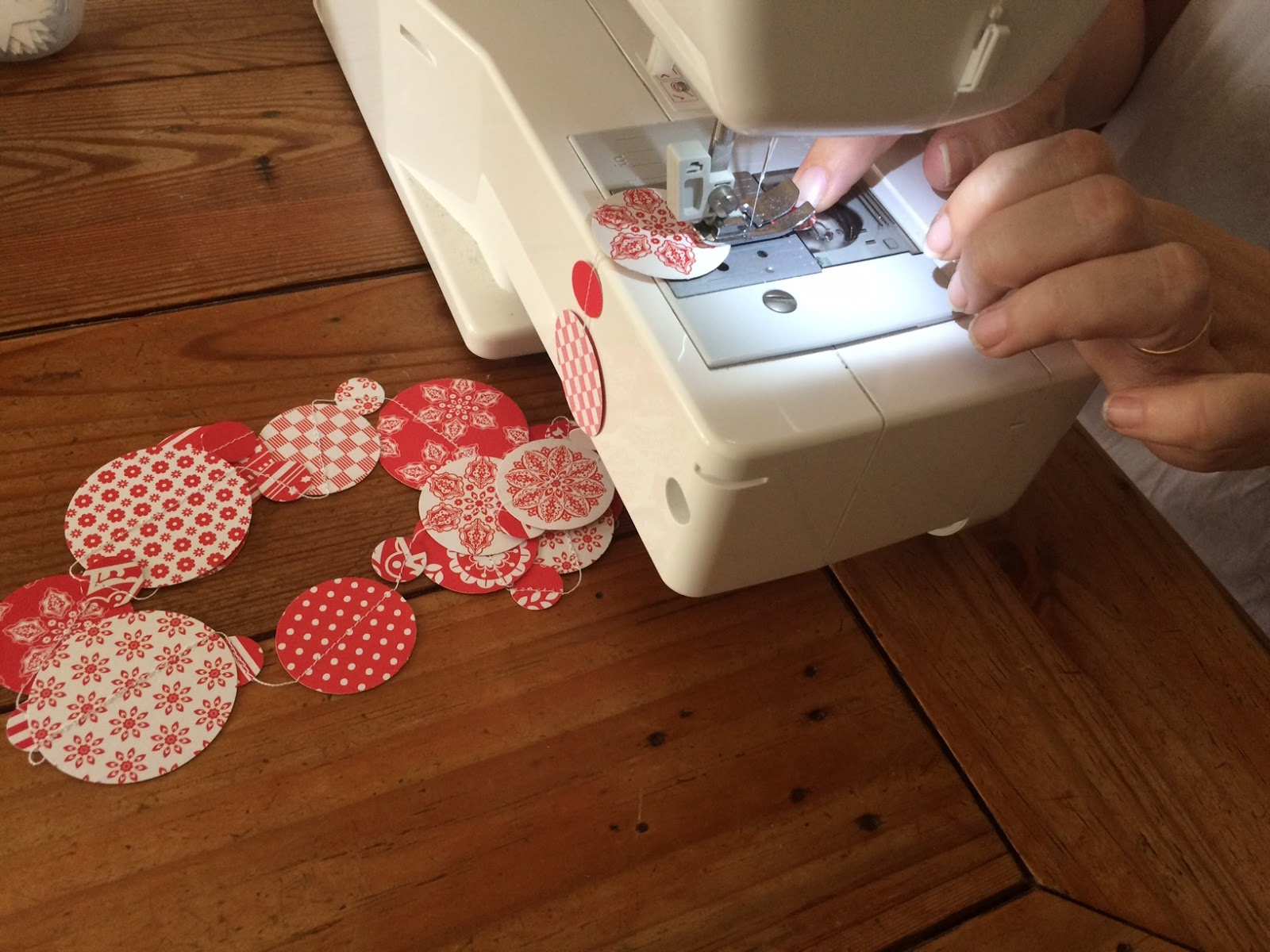 Sewing paper garlands at Christmas