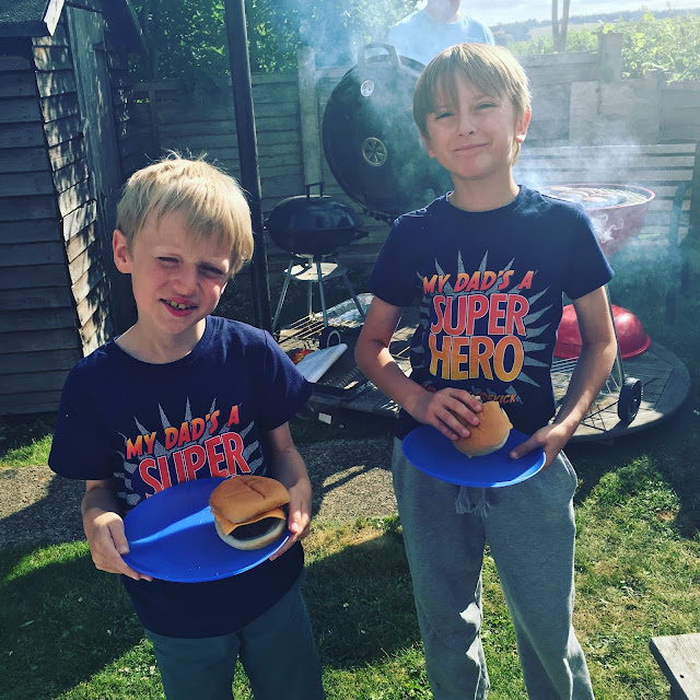 cousins eating BBQ burgers