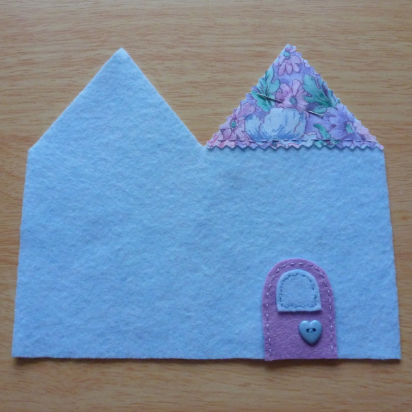 Felt door sewn onto handmade needlecase book needle holder