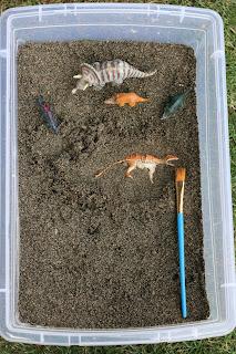sand sensory bin, archeology sensory bin, dinosaur sensory bin