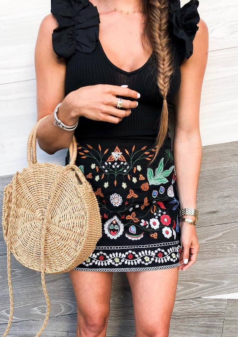 what to wear with an embroidered skirt : round bag and black top