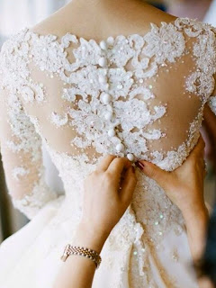 Lovely lace backed gown with stunning button detail
