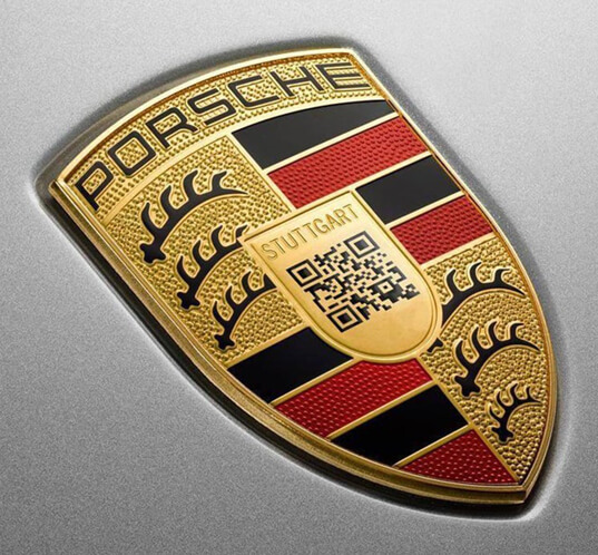 Porsche updated its crest with a QR logo to show what it might look like if their company embraced digital-first branding
