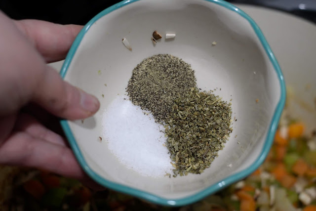 Salt, pepper, and Italian Seasoning in a small bowl.