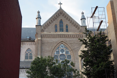 View of Transept looking between two apartment buildings on Broome Street