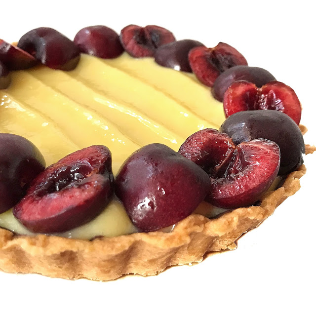 Buttery tart crust filled with lemon curd and fresh cherries