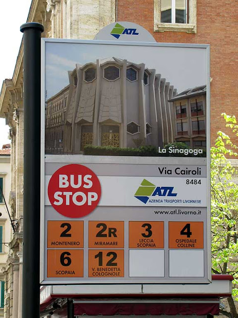 Bus stop sign illustrated with a picture of the Synagogue of Livorno